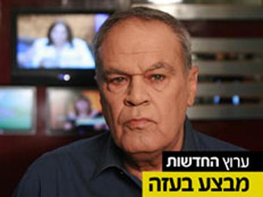 """הפרשן הצבאי של ערוץ 2, רוני דניאל, בפרומו לשידורי הערוץ בזמן מבצע """"עמוד ענן"""" (צילום מסך)"""