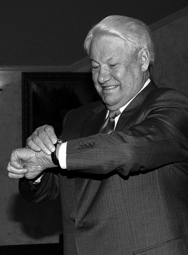 Former Russian President Yeltsin looks at watch while celebrating 75th birthday in Moscow