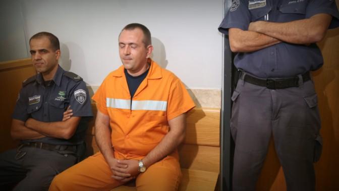 רומן זדורוב באחד הדיונים בערעורו על ההרשעה ברצח תאיר ראדה, בית המשפט בנצרת, 13.6.13 (צילום: פלאש 90)