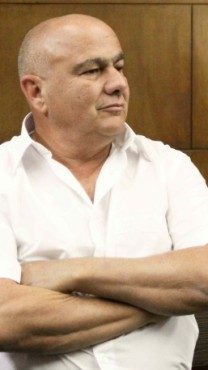 """יו""""ר בנק הפועלים לשעבר דני דנקנר ממתין להכרעת דינו, 31.3.14 (צילום: עידו ארז)"""