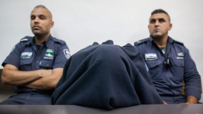 """שוטר מג""""ב החשוד בירי הקטלני בביתוניא, בית המשפט המחוזי בירושלים, 23.11.14 (צילום: יונתן זינדל)"""