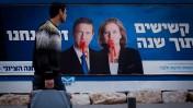 שלט תעמולת בחירות שהושחת. תל-אביב, 15.2.15 (צילום: אמיר לוי)