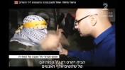 אוהד חמו מראיין חמוש במחנה קלנדיה (צילום מסך)