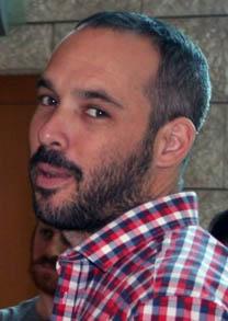 """יאיר טרצ'יצקי, יו""""ר ארגון העיתונאים, בבית-הדין לעבודה בבאר-שבע, 8.11.15 (צילום: אורן פרסיקו)"""